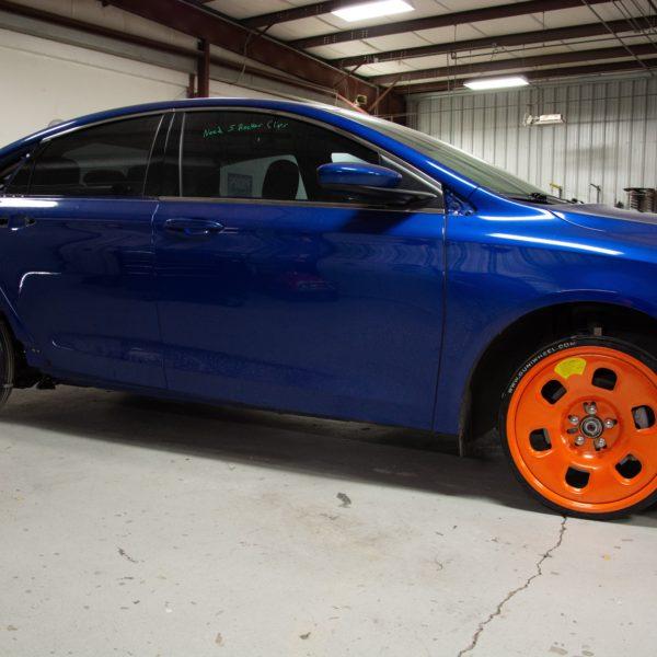Blue car using Guniwheel