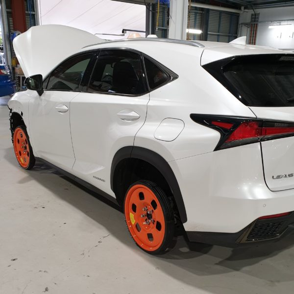 White car using Guniwheel in front and rear